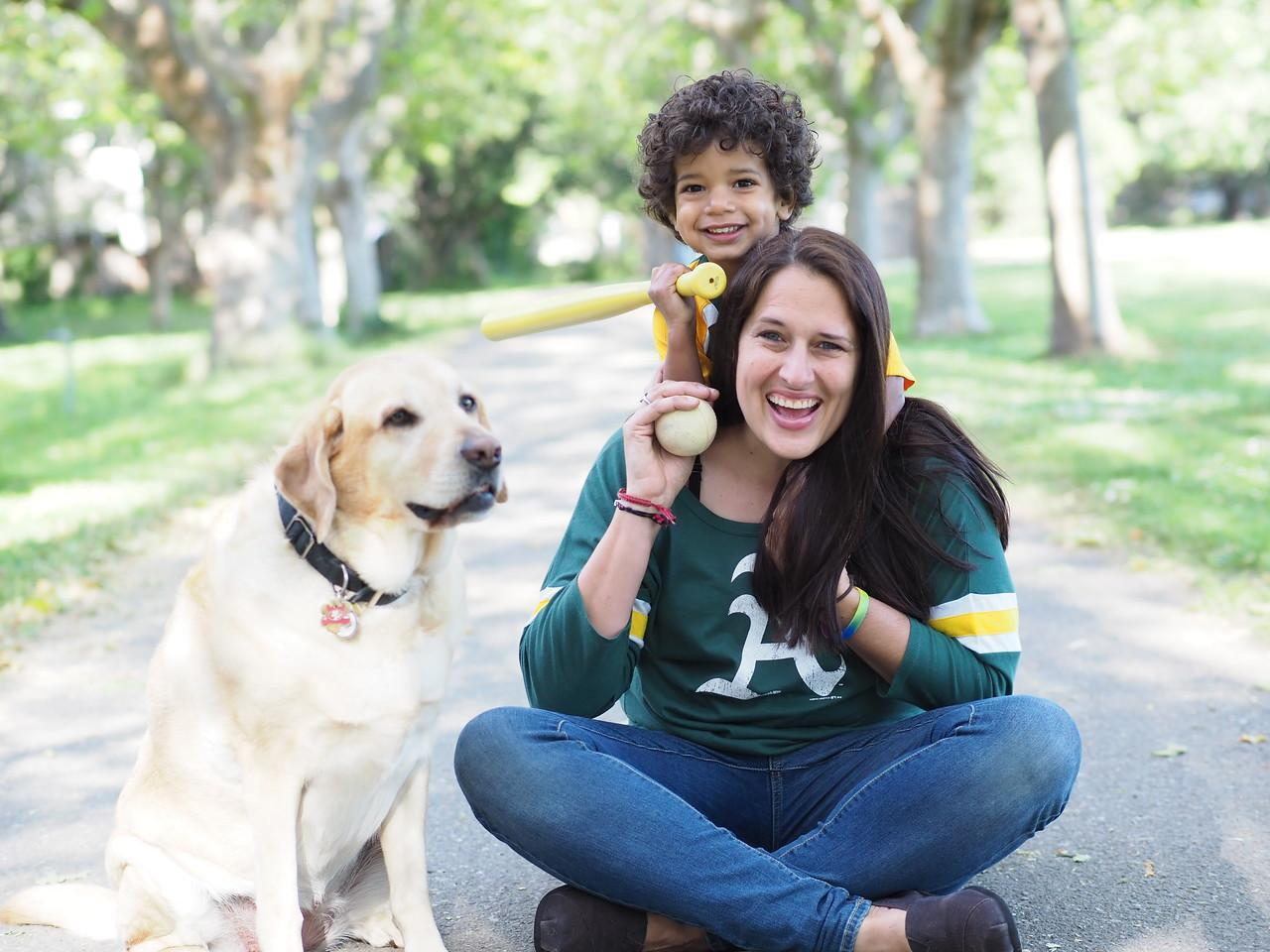 Photo of Kelly Abbott with dog and child