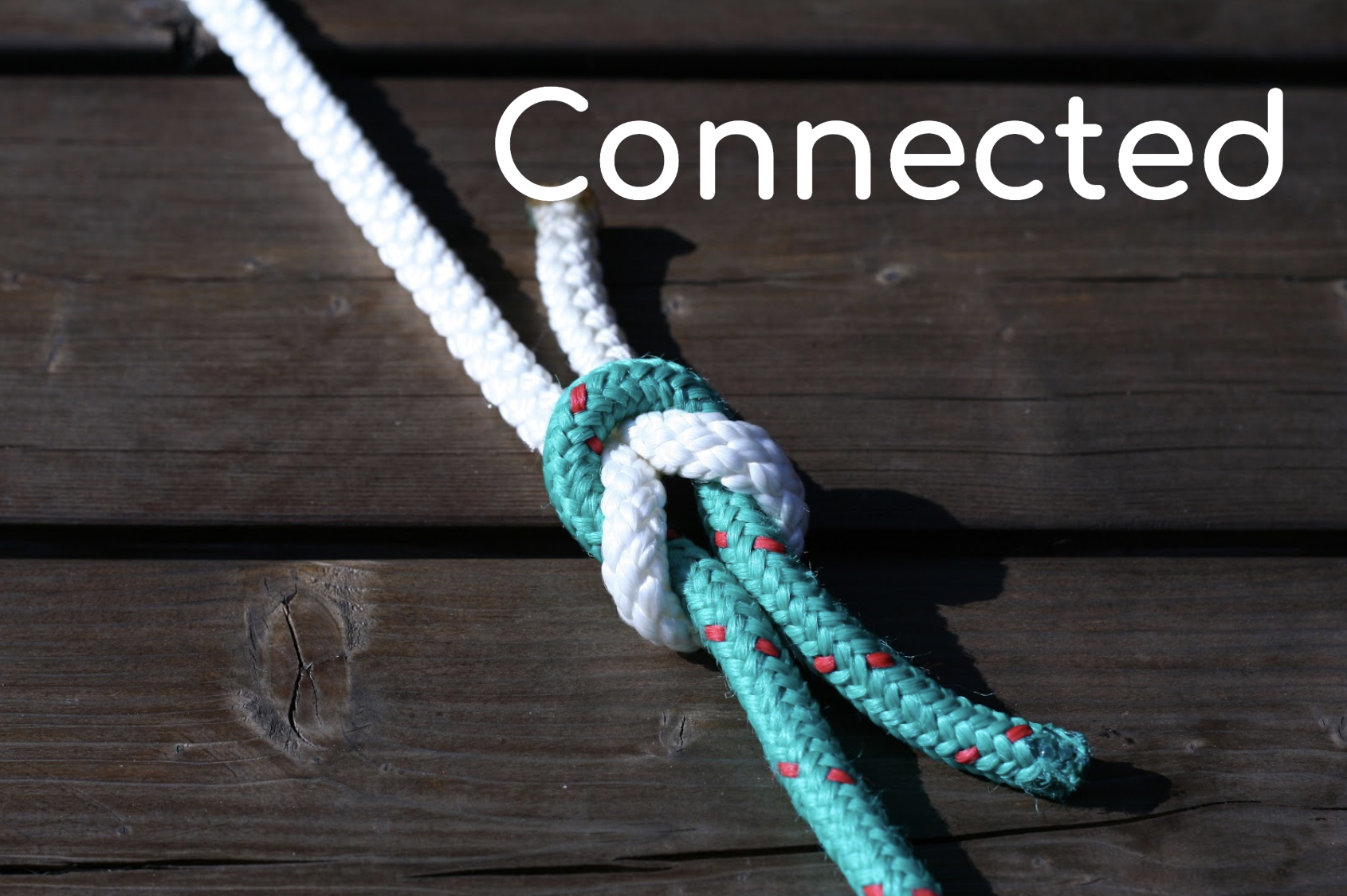 Photo of rope knotted, caption stating Connected.
