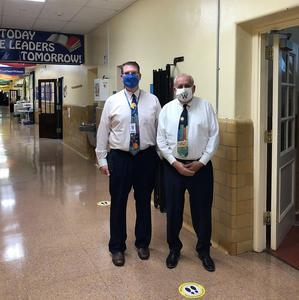 Photo of Wilson principal and guidance counselor wearing masks.