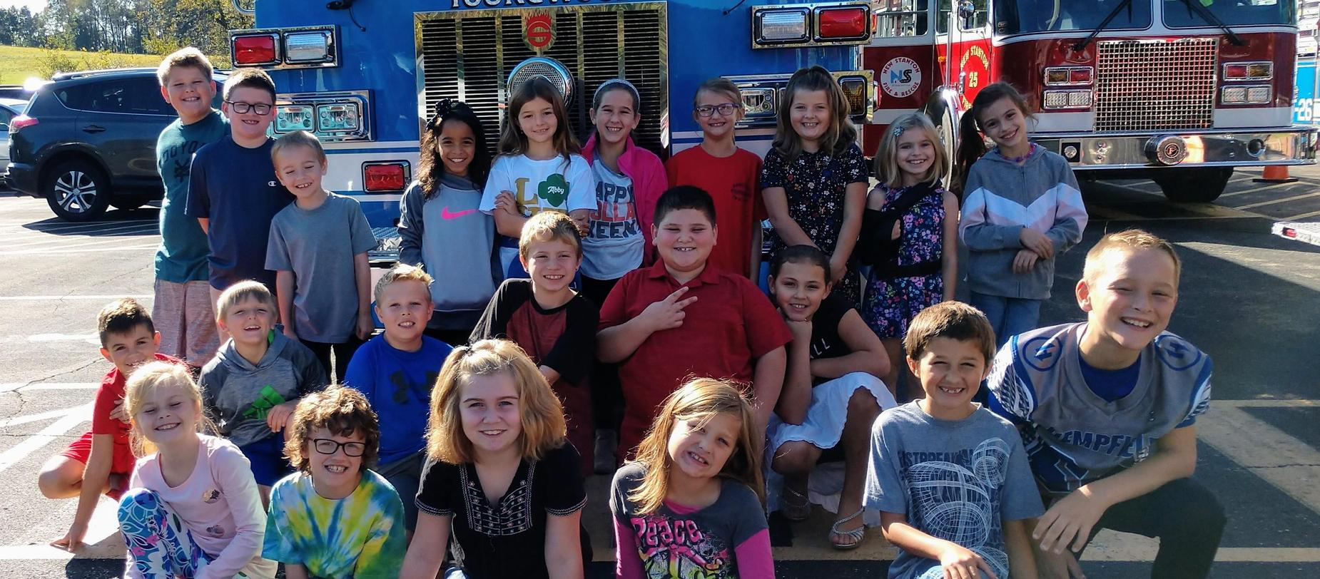 students and fire trucks