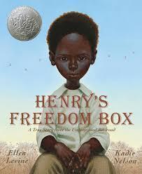 African American boy sitting on a box
