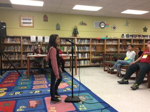 students competing in spelling bee.