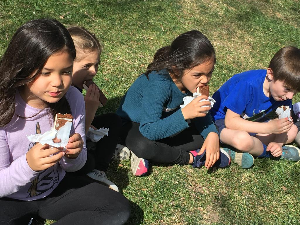 students eating ice cream sandwiches