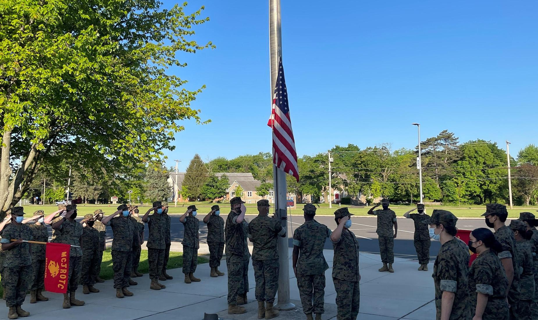 Bensalem High School MCJROTC Cadets salute the American Flag as they raise it early in the morning