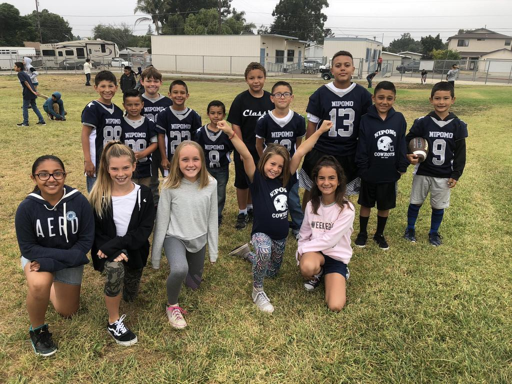 Nipomo Cowboy football players and cheerleaders at recess