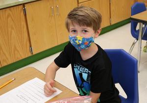 Photo of kindergartner at desk