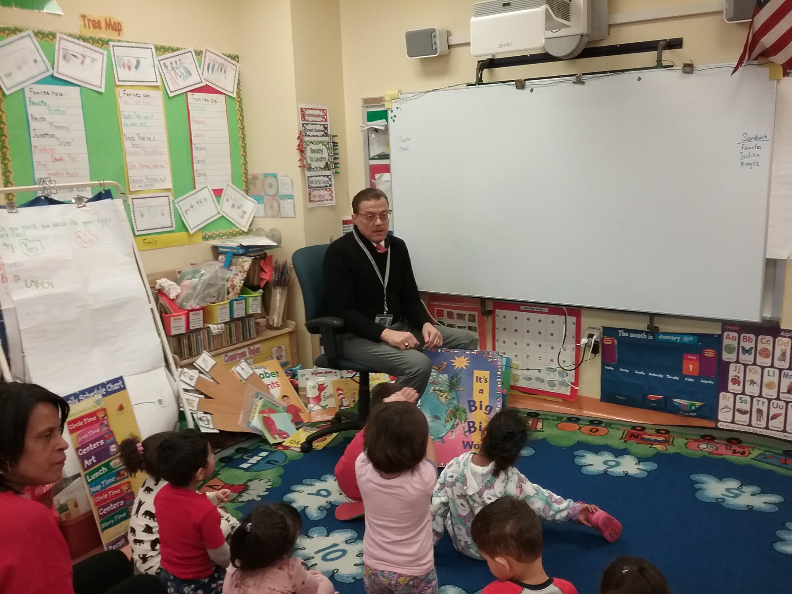 Charles Webster reading to students at ECC