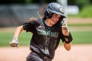 Coloma's Megan Koeningshof rounds third base as she sprints from first base to home plate as the third runner to score after a double hit by teammate Kayla Yore in the sixth inning on Friday, June 15, 2018 at Michigan State University's Secchia Stadium in East Lansing.