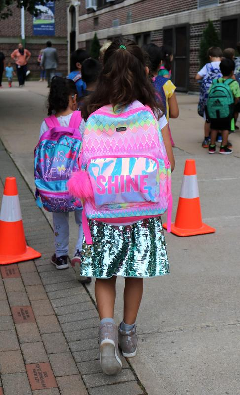 McKinley School 1st grader sports a backpack that says