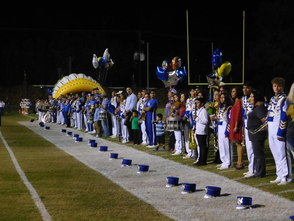 seniors with parents on senior night on the sidelines