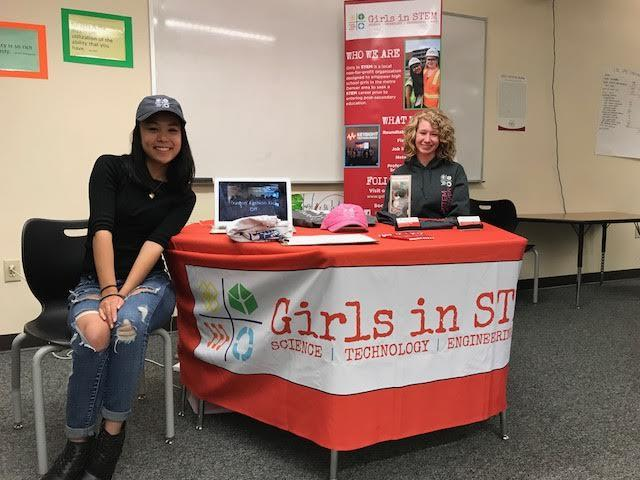 Girls in STEM represents their group at the High School Showcase Night.