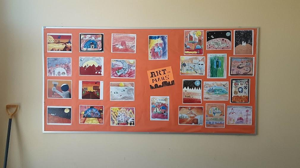 A board displaying artworks inspired by the Mars Perseverance mission, grades K through 5