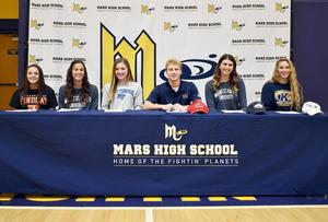 Mars Area HighSchool seniors (from left)Madison Myers (track & field), Carsyn Hetzler (track &field), Taylor Hamlett (soccer), Joseph Craska (baseball), Bella Pelaia (basketball) and Mara Fuller (lacrosse) signed letters of intent to continue their sports careers at the college level.
