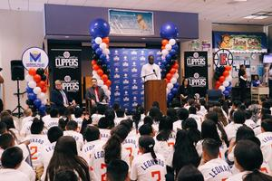 Kawhi Leonard making announcement about a backpack giveaway