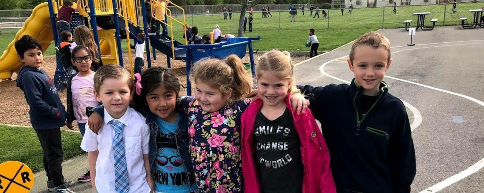 students smiling together in playground