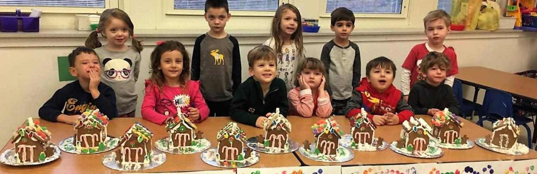 Lincoln School students display gingerbread houses they made in class for the season.
