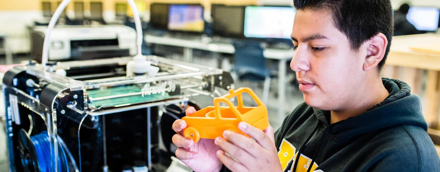 Boy with 3D printer