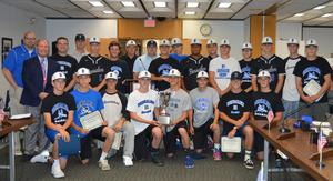 BHS Owls Baseball team pose for a photo at a school board meeting where they were recognized for their history making, winning season.