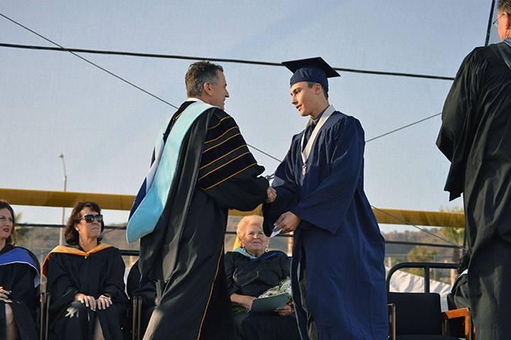 Dr Domene congratulates a student
