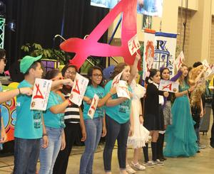 "Edinburg CISD students proudly display ""A"" rating signs during the district's General Assembly at the McAllen Convention Center."