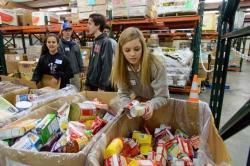 Students sorting food at Golden Harvest