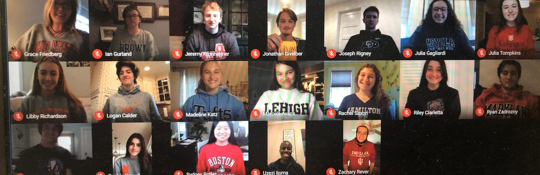 Photo of computer screen of students wearing college shirts on College Decision Day.