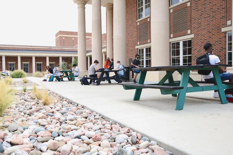 students sitting at picnic tables