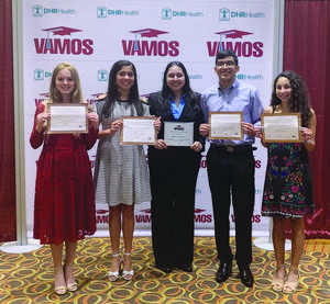 McAllen Memorial High counselor Maria Carrillo, center, stands with her Counselor of the Year award from VAMOS. With her, from left to right, are 2019 student scholarship recipients Elizabeth Avalos, Valeria Gomez, Keven Hernandez and Ximena Zuniga.