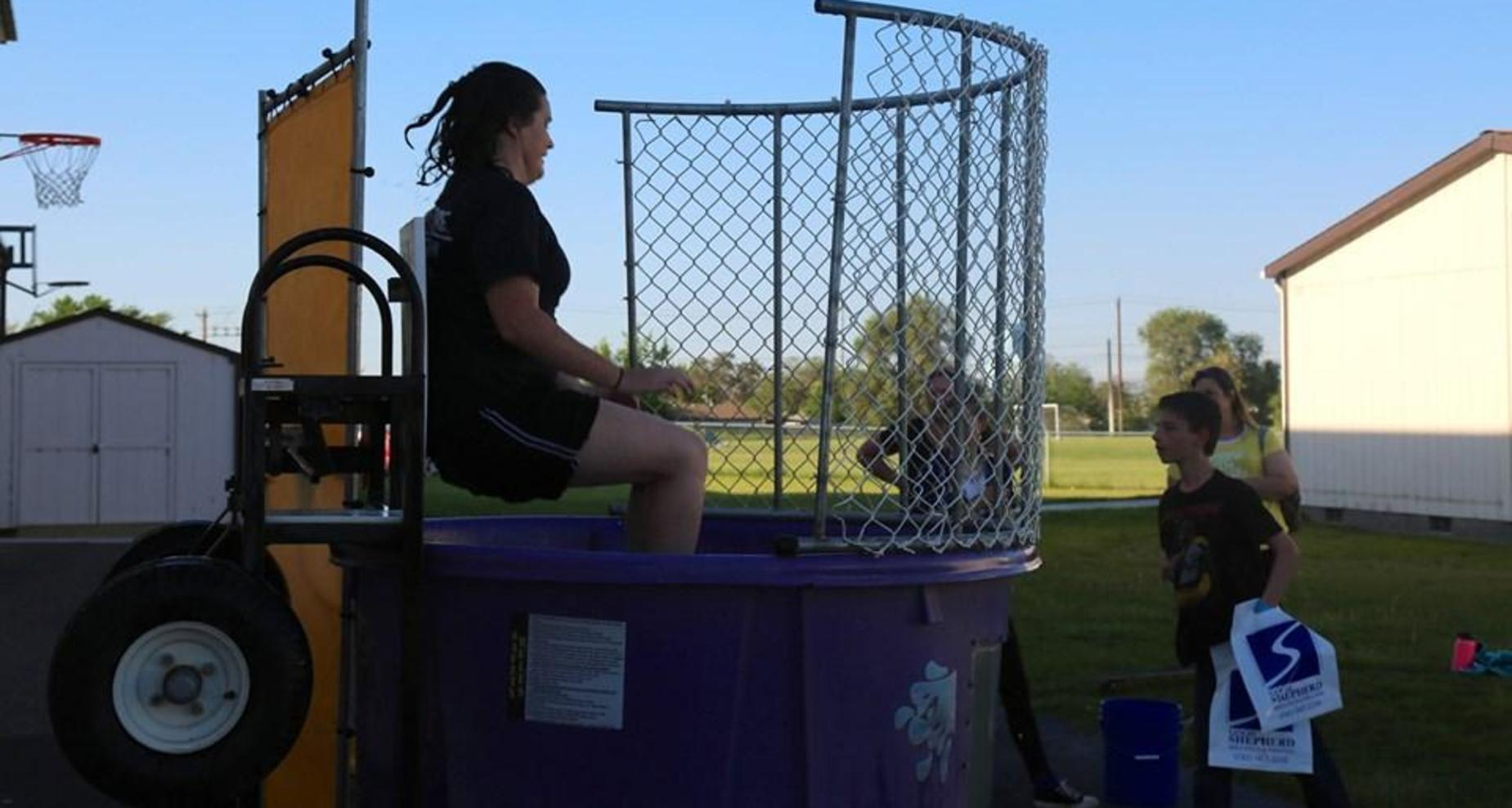 RH teacher gets dunked during carnival.