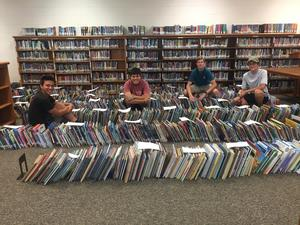 Moving the books and bookcases was hard work. Thanks, guys!