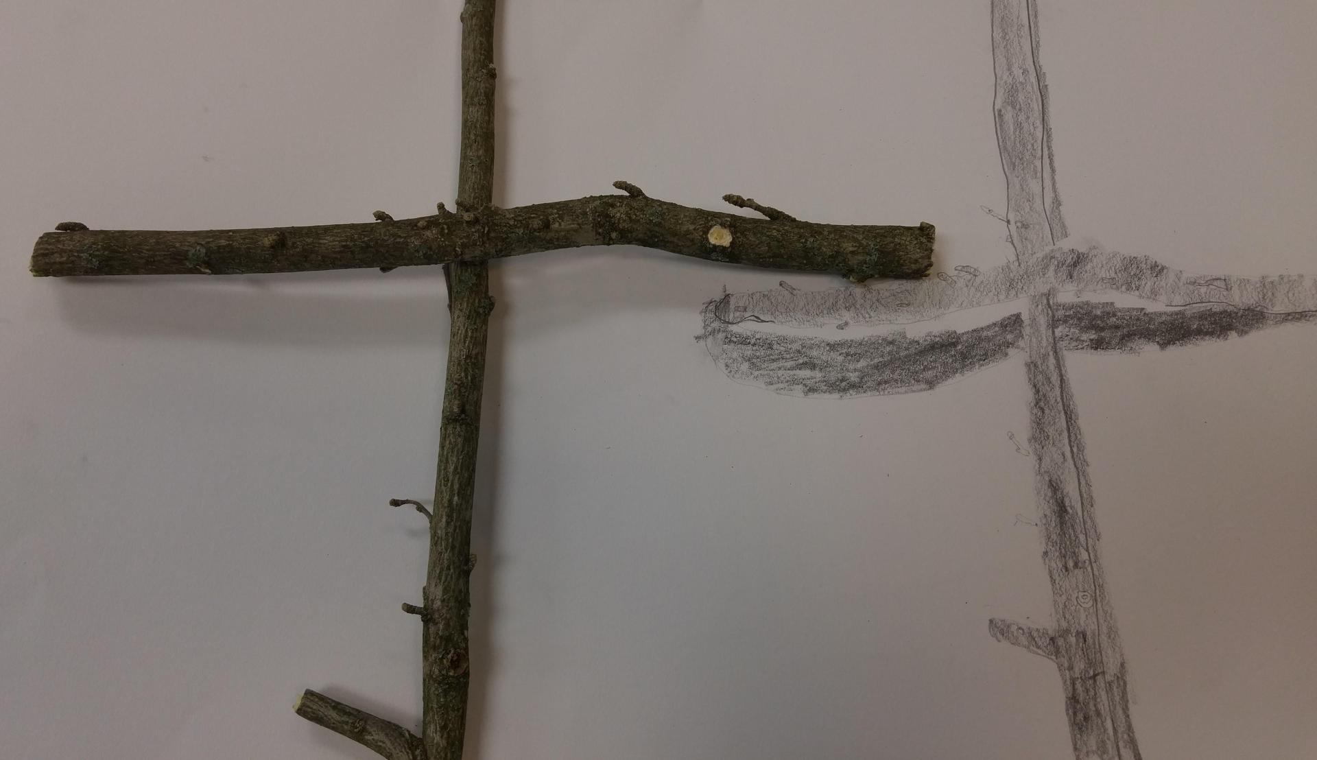 stick cross and drawing