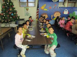 kids in pjs waiting to eat their breakfast