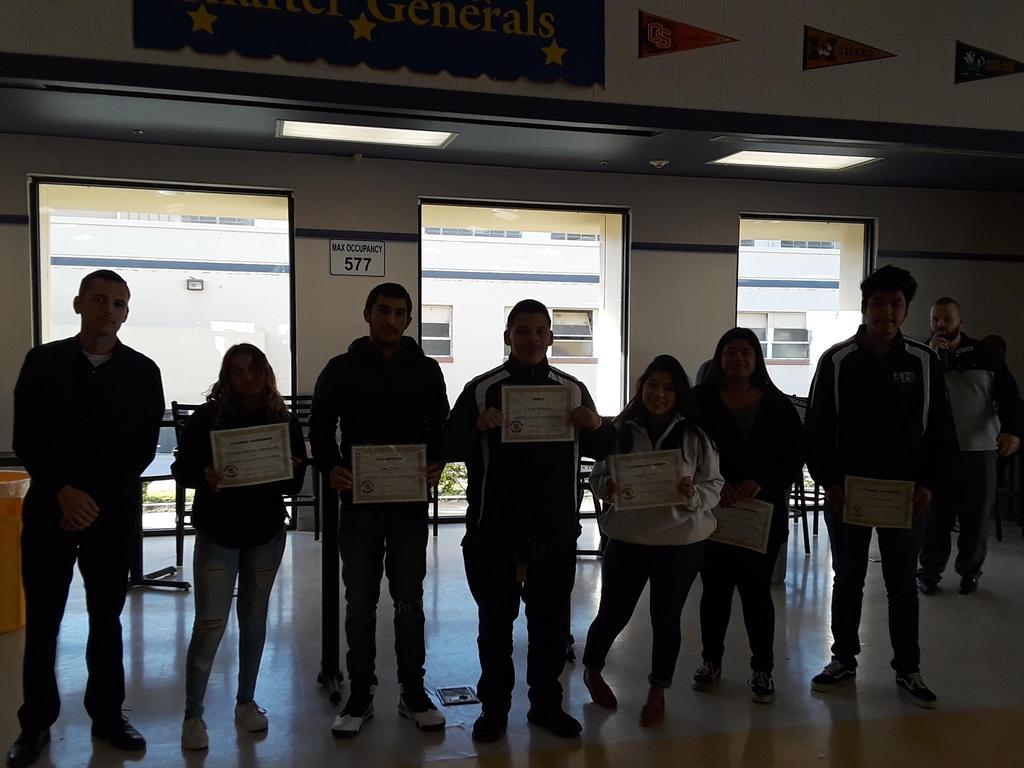 Mr. Carney's students receive their awards