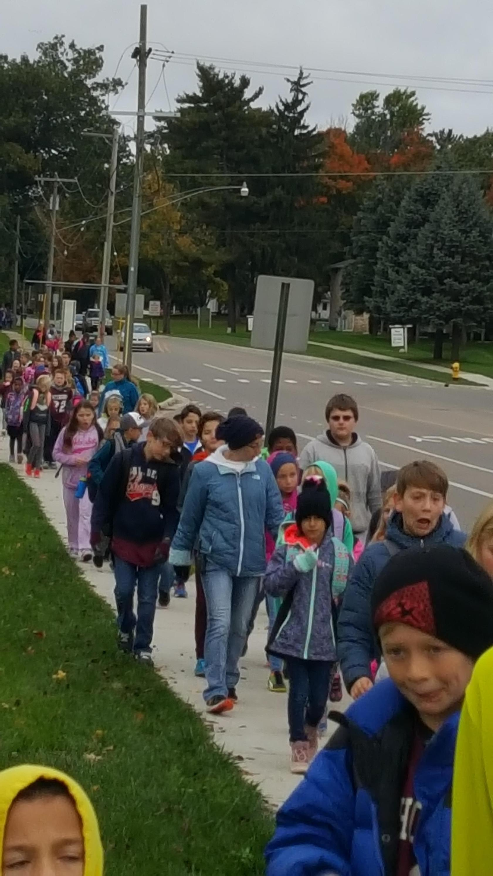 Photo of kids walking on walk to school day