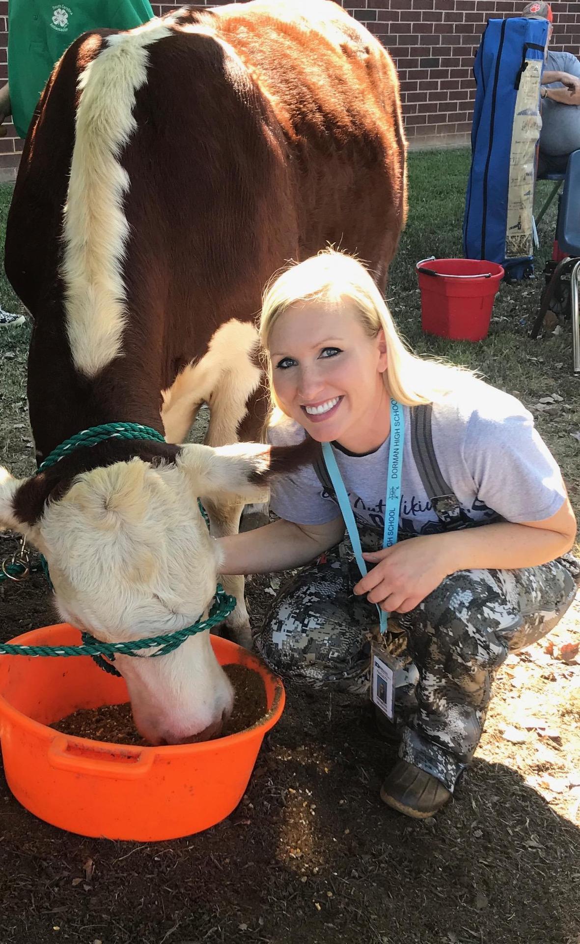 female teacher with a cow