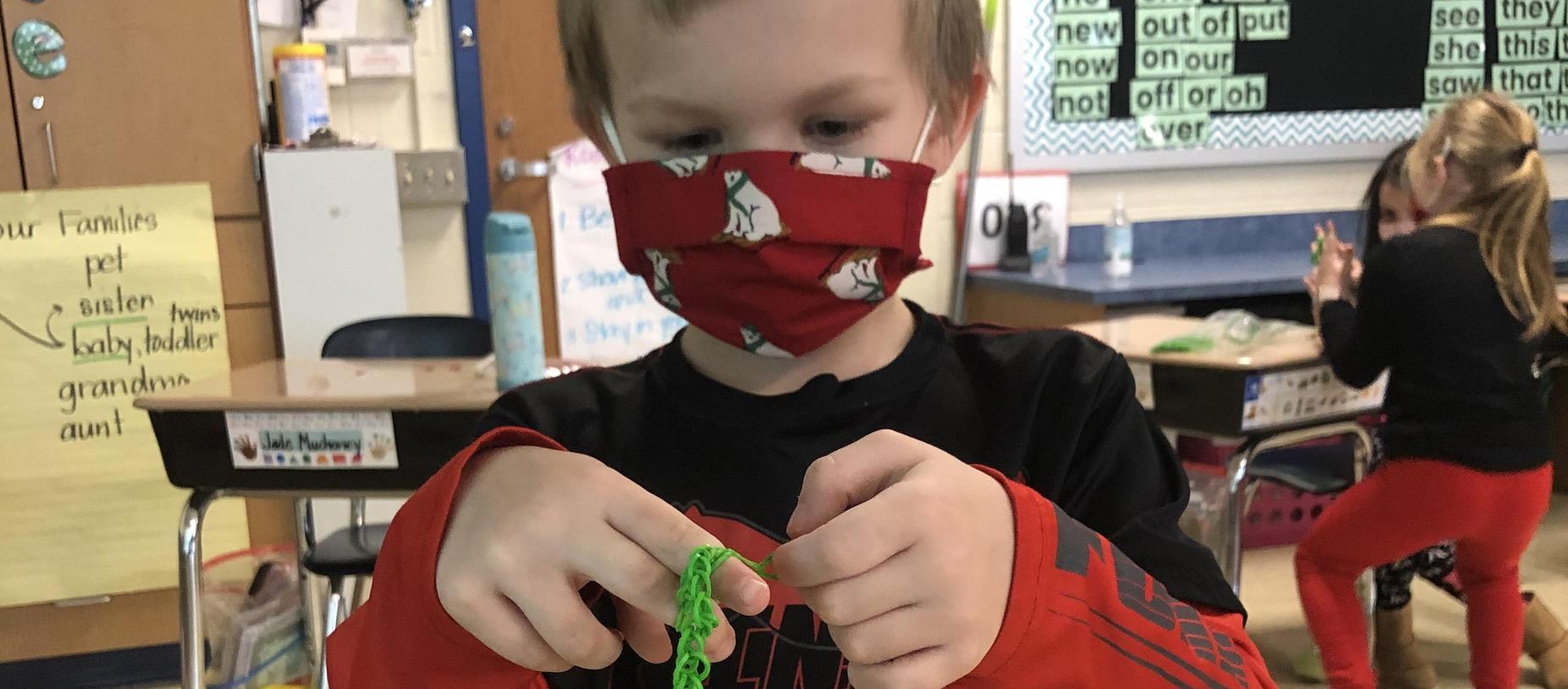 student making a bracelet