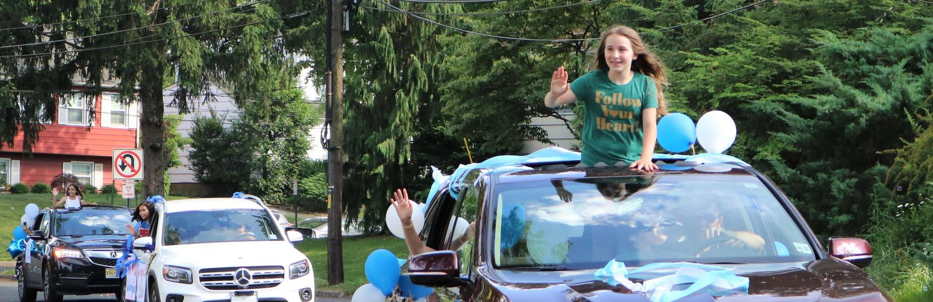 Photo of Washington 5th graders waving during Grade 5 Clap Out Car Parade.