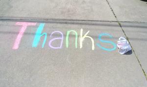 A chalk side on the sidewalk that says