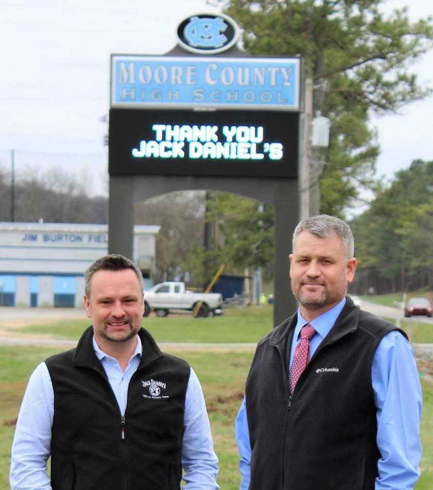 Mr. Moorehead with the new Jack Daniels' donated sign