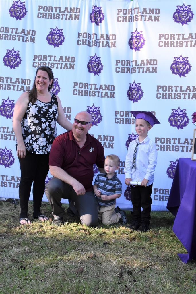 Kindergarten graduate and family