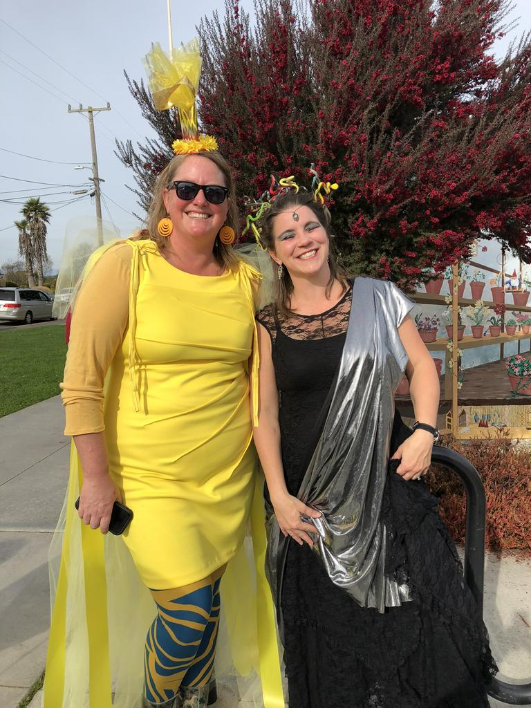 Parents dressed as a ray of sunshine and Medusa