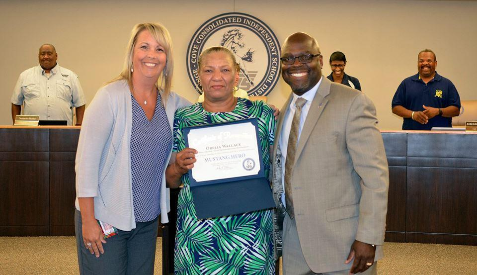 Orelia Wallace receiving recognition from school board