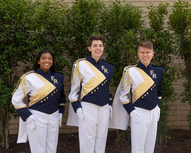 Pictured are Drum Majors Keethu Shriram, Lane Kline, and Ethan Leicht.
