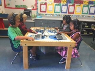 Children at the listening center in class