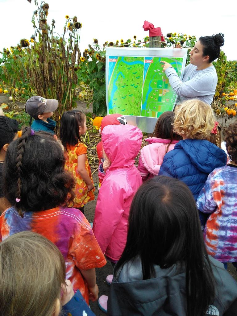 Children listening to the history of the pumpkin patch