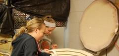High School students use a Kiln to fire their projects.
