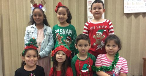 students posing in Christmas attire.