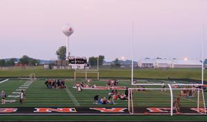 Students gathered as the sun came up on their first day of their senior school year.