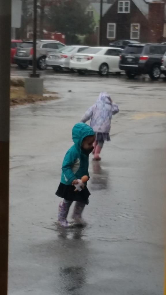 students dancing in the rain