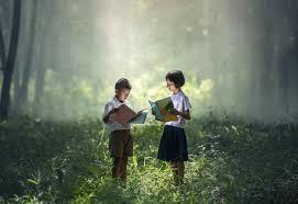 Two children reading books in sunlight
